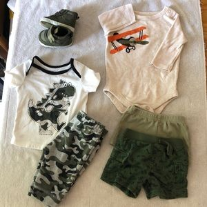 Gently used baby boy clothes and a pair of shoes